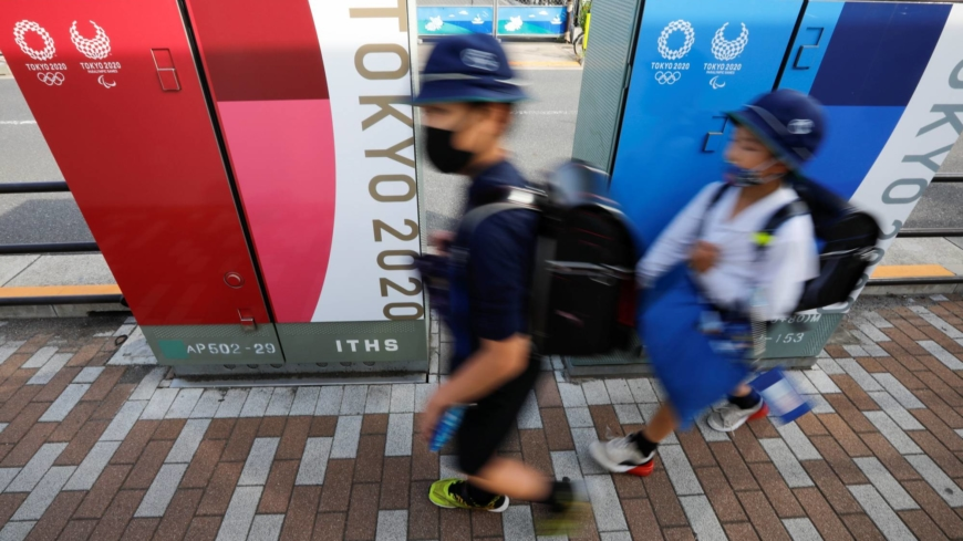 Japan rules out asking for blanket school closures amid virus surge