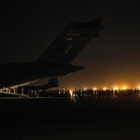 Afghan civilians are evacuated by the U.S. military at an undisclosed location on Thursday.   | U.S. CENTRAL COMMAND PUBLIC AFFAIRS / VIA AFP-JIJI
