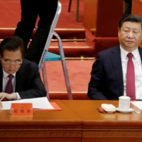 Chinese President Xi Jinping and former President Hu Jintao in October 2017.  | REUTERS