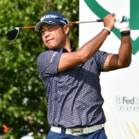 Hideki Matsuyama hits his tee shot on the 17th hole during the first round of The Northern Trust golf tournament at the Liberty National Golf Club in Jersey City, New Jersey. | MARK KONEZ / USA TODAY SPORTS