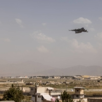 A military cargo plane takes off from the airport in Kabul on Saturday.  | JIM HUYLEBROEK / THE NEW YORK TIMES