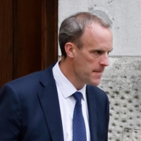 Britain's Foreign Secretary Dominic Raab heads for Downing Street in London on Friday.  | AFP-JIJI