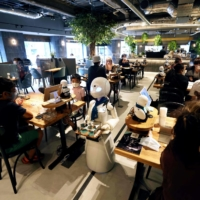 Dawn Cafe's launch comes as the Tokyo Paralympics get underway. | AFP-JIJI