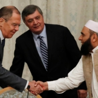 Russian Foreign Minister Sergei Lavrov meets with members of a Taliban delegation during peace talks in Moscow in November 2018. Moscow, with its deep influence in Central Asia, holds the key to rebuilding the war-torn Afghanistan.    REUTERS