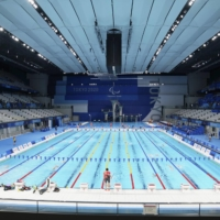 Paralympic swimmers practice at the Tokyo Aquatics Centre on Friday.   KYODO