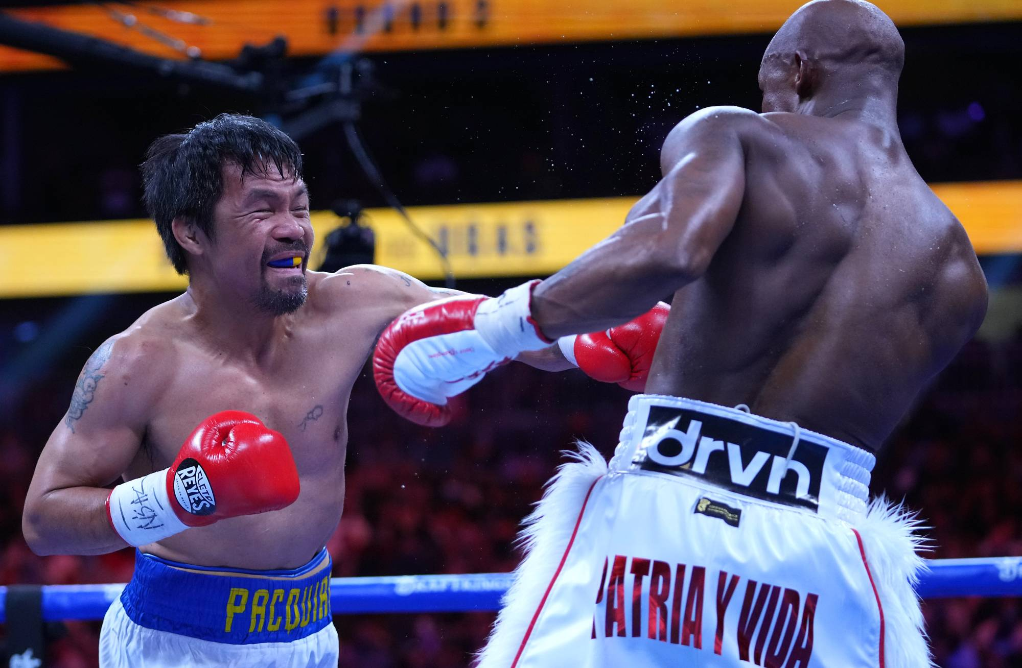 Manny Pacquiao (left) fights Yordenis Ugas in their championship bout at T-Mobile Arena in Las Vegas on Saturday.    USA TODAY / VIA REUTERS