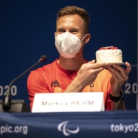 Germany's Markus Rehm receives a cake for his birthday during a news conference in Tokyo on Sunday. | AFP-JIJI