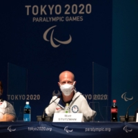 From left: Mexio's Amalia Perez, Matt Stutzman of the United States, and Uganda's Husnah Kukundawke speak during a news conference at Tokyo Big Sight. | AFP-JIJI