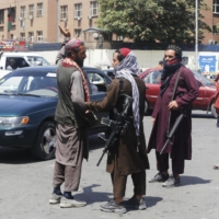 Taliban soldiers in central Kabul on Saturday   KYODO