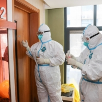 Medical staff members collect samples to be tested for COVID-19 at a quarantine hotel in Lianyungang, in China's eastern Jiangsu province, on Thursday.  | AFP-JIJI