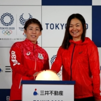 Paratriathlon athlete Mami Tani (right) poses with Olympic wrestler Saori Yoshida Japan's Olympic wrestler Saori Yoshida during  a promotional event for the 2020 Tokyo Games in September 2016.   REUTERS