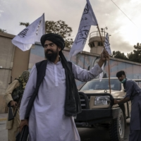 Taliban members outside the closed U.S. Embassy in Kabul on Sunday | VICTOR J. BLUE / THE NEW YORK TIMES