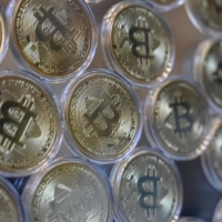 The Financial Services Agency is discussing the introduction of stricter regulations on cryptocurrency assets in Japan. | AFP-JIJI