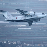 An Air Self-Defense Force C-2 transport plane takes off for Afghanistan from ASDF Iruma base in Sayama, Saitama Prefecture, on Monday.   KYODO
