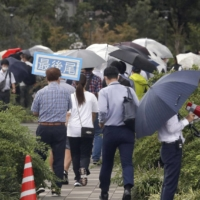 People gather to hear a ruling on the head of the Kudo-kai crime syndicate at the Fukuoka District Court on Tuesday. | KYODO