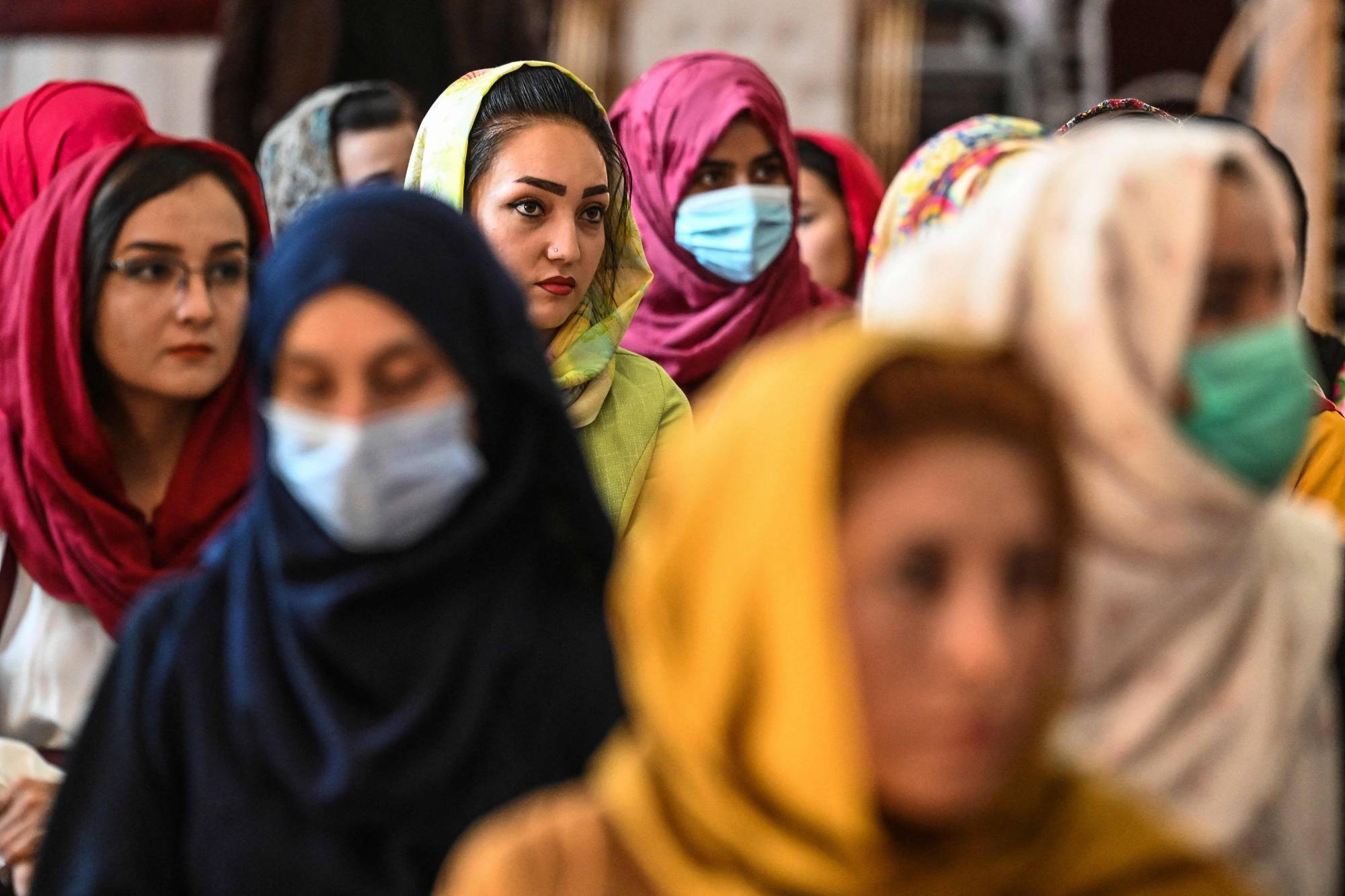 Afghan women take part in a gathering in Kabul on Aug. 2 to speak out against human rights violations by the Taliban regime. | AFP-JIJI