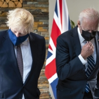 U.S. President Joe Biden meets with British Prime Minister Boris Johnson during the U.K.-sponsored G7 summit in June. The world's democracies can no longer rely on America to guarantee their security needs.  | DOUG MILLS / THE NEW YORK TIMES