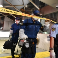 Suspect at large after two injured in Tokyo subway acid attack
