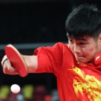 Shuai Zhao of China in action against Gyula Zborai of Hungary on Wednesday at Tokyo Metropolitan Gymnasium.    REUTERS