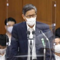 Shigeru Omi, chair of the government subcommittee on the coronavirus response, speaks at a Diet committee session Wednesday. | KYODO
