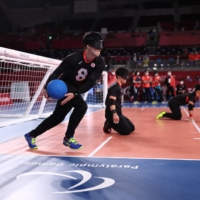 Japan plays Algeria in a Paralympic men's goalball match at Makuhari Messe in Chiba on Wednesday. | REUTERS