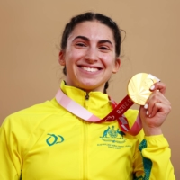 Gold medalist Paige Greco of Australia celebrates her gold medal in the women's C1-3 3000-meter individual pursuit.    REUTERS