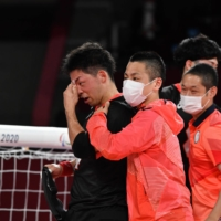 Members of Japan's men's Paralympic goalball team celebrate following their 13-4 win over Algeria on Wednesday in Chiba.  | DAN ORLOWITZ