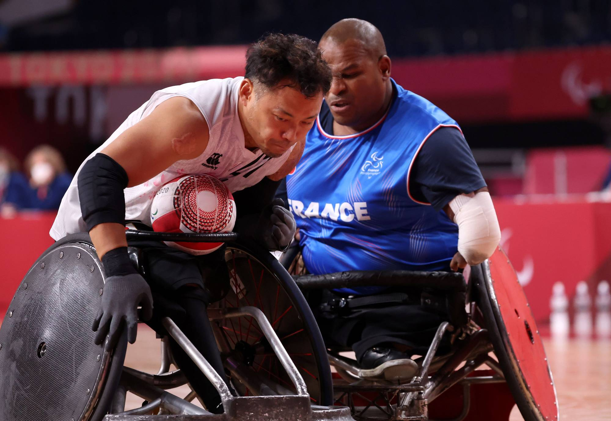 Japan's Yukinobu Ike (left) tries to get past France's Cedric Nankin during their wheelchair rugby match   REUTERS