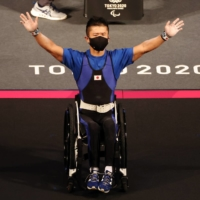 Past and present collide at Tokyo Games for Japanese powerlifter