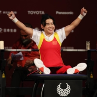 Lingling Guo of China celebrates during the final of the women's under-41 kg powerlifting final at Tokyo International Forum on Thursday.  | REUTERS