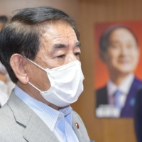 Liberal Democratic Party policy chief Hakubun Shimomura speaks to reporters at the LDP headquarters in Tokyo on Aug. 19. | KYODO