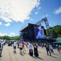 People gather at the main Green Stage of the Fuji Rock Festival in a photo provided by the festival's organizers.  | © UCHUTAISHI STAR