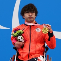 Swimmer Takayuki Suzuki wins Japan's first gold medal of the 2020 Tokyo Paralympics.   REUTERS