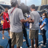 Talking points: Ekaterina Ulanova (far right) stands by as an athlete representing the Russian Olympic Committee is interviewed. | COURTESY OF EKATERINA ULANOVA