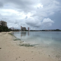A mostly empty beach at Tumon Bay, Guam, on Aug. 21. Guam once welcomed 1.7 million visitors a year. That number has fallen to a tiny trickle.  | ANTHONY HENRI OFTANA / THE NEW YORK TIMES