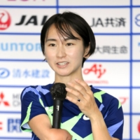 Sae Tsuji speaks during a media event in April.  | KYODO
