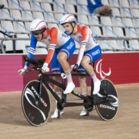 France's Corentin Ermenault (left) and Alexandre Lloveras compete in the men's B 4000m individual pursuit cycling event during the Tokyo Paralympic Games at Izu Velodrome in Shizuoka Prefecture.  | AFP-JIJI