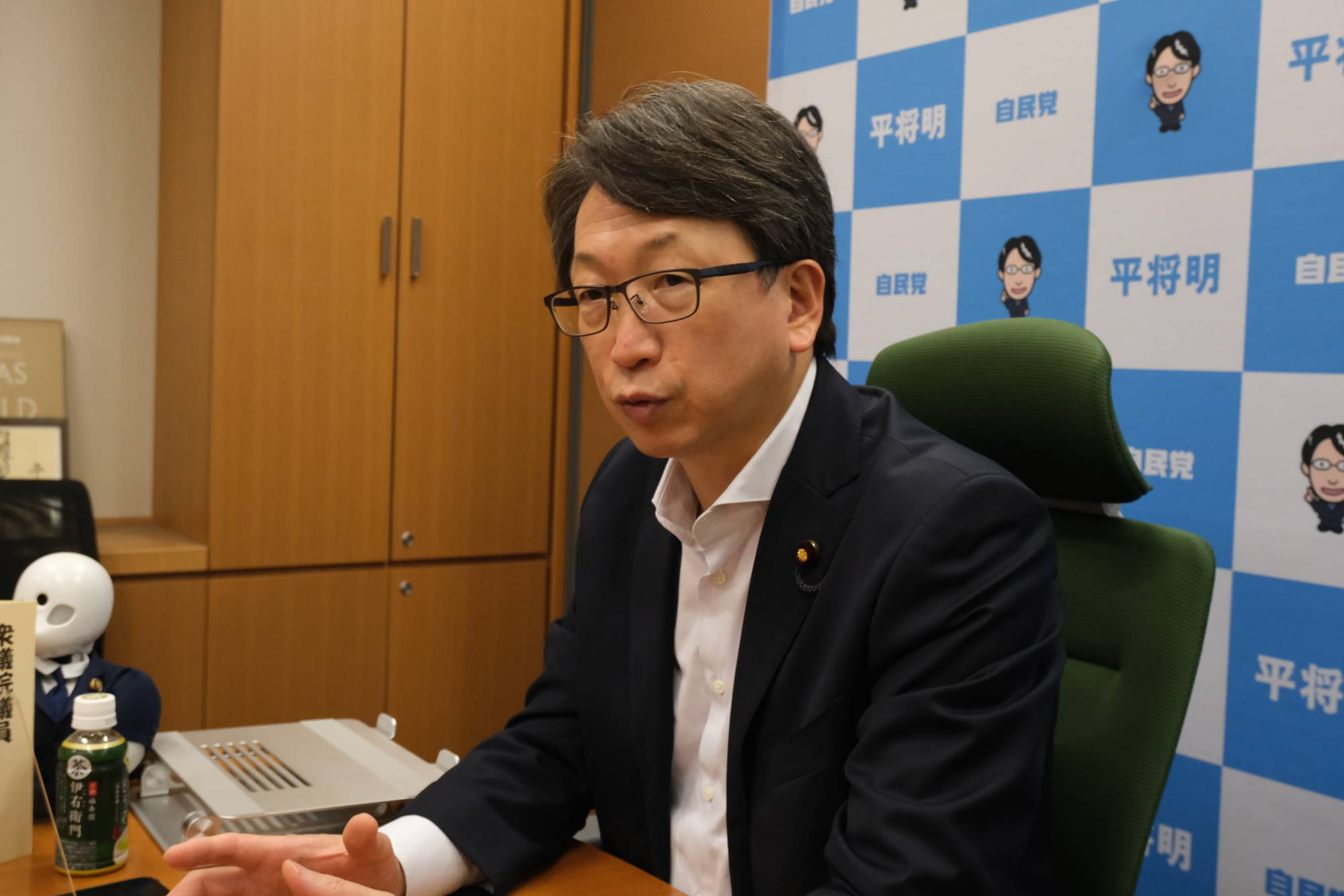 Masaaki Taira, former state minister of Cabinet Office in charge of information technology policy, speaks during an interview in August in Tokyo. | KAZUAKI NAGATA