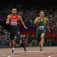 Germany's Heinrich Popow (right) reacts as he wins the men's 100-meter T42 final during the London 2012 Paralympics.  | REUTERS
