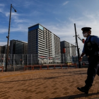 A police officer on patrol at the athletes village earlier on Monday.  | REUTERS