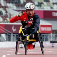 Tomoki Sato reacts after winning the men's T52 400-meter final during the Tokyo Paralympics at National Stadium on Friday. | REUTERS