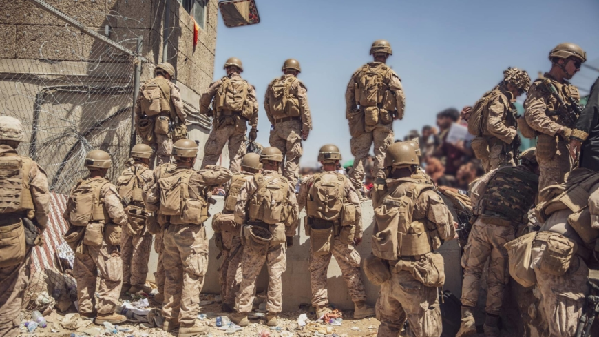 As U.S. troops searched Afghans, a bomber in the crowd moved in