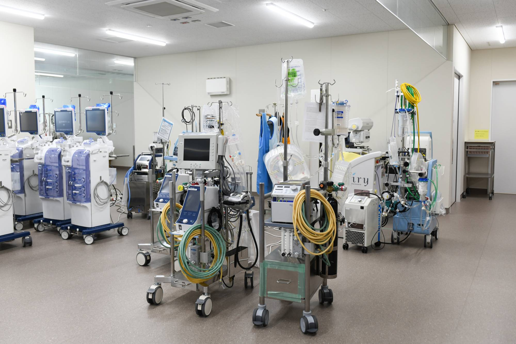 Medical equipment, including extracorporeal membrane oxygenation (ECMO) machines, sit in the intensive care unit at Chiba University Hospital in the city of Chiba on Wednesday | BLOOMBERG