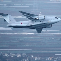 An Air Self-Defense Force C-2 transport plane takes off to Afghanistan from the ASDF's Iruma air base in Sayama, Saitama Prefecture, on Aug. 23.  | KYODO
