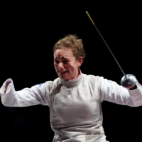 Italian fencer Beatrice Vio celebrates after winning a gold medal in the women's individual foil category B at the 2020 Tokyo Paralympics on Saturday. | AFP-JIJI