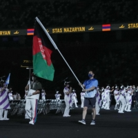 The flag of Afghanistan is carried out at the opening ceremony for the Tokyo Paralympics on Tuesday.  | AFP-JIJI