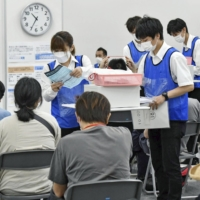 People who received their first dose of AstraZeneca PLC's vaccine at a mass inoculation site in Osaka last week   POOL / VIA KYODO
