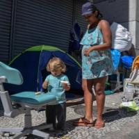 Daniela Rosa Neves and her son Riquelme by a tent at Patriarca Square in Sao Paulo on Aug. 19 | AFP-JIJI