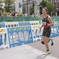Mami Tani competes in the women's PTS5 triathlon on Sunday in Tokyo.  | KYODO