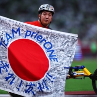 Japan's Tomoki Sato celebrates after winning another gold medal at Paralympic Games in Tokyo on Sunday. | REUTERS